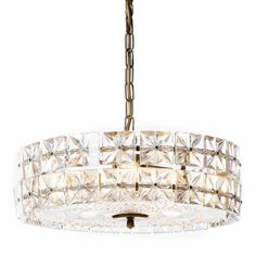Magnificent chandelier featuring hand-cut square-shaped crystals glass with faceted-stars. The fixture has a circular design with a flat center. Equipped with six-lights and each square prism is a stylized bolt fitting in chrome. It was produced in the 1970s by the iconic firm Kinkeldey lighting based in Germany.