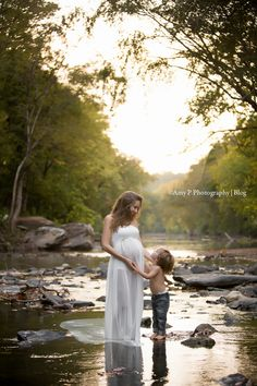 This creek was such a beautiful location in Mountain Brook to take these Maternity photos! This white gown went perfectly with the rocks and overall background! Newest addition is a baby girl! but this mommy and son moment is just so special!