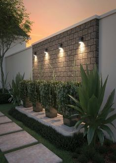Neutrino LED Outdoor Wall Sconce is part of Outdoor landscape lighting - With a minimalist modern approach in mind, the Neutrino compact outdoor sconce l Backyard Patio Designs, Small Backyard Landscaping, Landscaping Ideas, Garden Wall Designs, Modern Backyard Design, Mulch Landscaping, Outdoor Wall Lighting, Outdoor Walls, Lighting Ideas