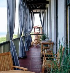I absolutely love, love curtains on a porch - charming! Outdoor Curtains For Patio, Balcony Curtains, Patio Canopy, Outdoor Balcony, Canopy Outdoor, Outdoor Rooms, Outdoor Living, Red Curtains, Balcony Ideas