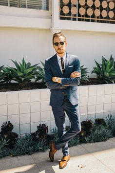 Tailored suit, brown shoes
