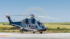 Photo about A helicopter on ground on heliport in the middle of green field. Copy space on top on clear blue sky. Image of transportation, flying, airport - 25787846 Clear Blue Sky, Green Fields, Fighter Jets, Transportation, Aviation, Aircraft, Middle, Stock Photos, Space