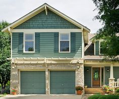 Distinct blue-green color gave this home a major curb appeal boost! See the before here: http://www.bhg.com/home-improvement/garage/ideas-inspiration/garage-doors-10-garage-makeovers/?socsrc=bhgpin051215beforedeftdetail&page=3