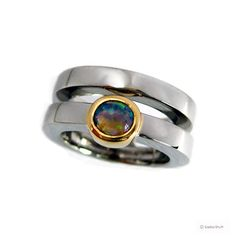 Stylish engagement & wedding ring, handmade in white gold and set with an Australian opal in a yellow gold setting. Wedding Engagement, Wedding Rings, Handmade Engagement Rings, Australian Opal, Magpie, Gemstone Rings, Rings For Men, White Gold, Jewellery