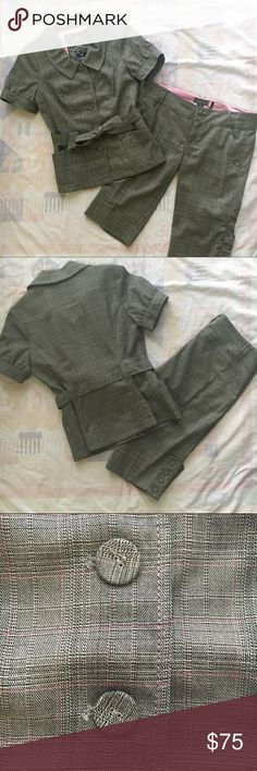 """Guess Dressy Cropped Suit Worn once! For just a few hours at a wedding. Very flattering, fitted jacket with tie belt and short sleeves. Size Medium. Shorts are size 29 (M). And are 22"""" overall, with a 6"""" rise and 15"""" inseam. Heather gray plaid with pink accents throughout. Cute button detail on outside of legs. PERFECT for a dressy afternoon wedding or even for workwear. Wooden hangers and dust bag included. Guess by Marciano Tops Blouses"""