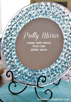 Glue transparent gems and a small round mirror onto a plastic charger plate to make a stained glass vanity mirror.