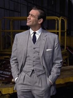 very very nice suit . defo prefer the tie to a bow tie and loving the hankie.