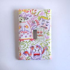 Funny Crayon Monsters Light Switch Plate in White with Bright Primary Colors by vpauld on Etsy