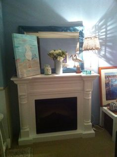 Seagull painting on mantel - I painted it!!! Great for the coastal decor!