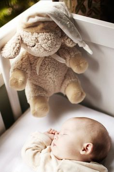 Sleep Sheep with smart sensor that activates soothing sounds when baby is awake