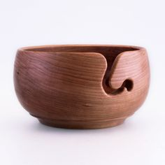 YARN BOWL - LARGE 120.00 Handcrafted Yarn Bowls are available in Cherry measuring approximately 7″ in diameter, 4″ deep. Being handmade, each Yarn Bowl is unique unto itself, turned and hand sanded to an extremely fine finish assuring a smooth surface. A hand-rubbed natural beeswax finish brings out the beauty of the wood.
