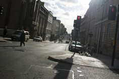 Crossing a street in the center of Glasgow at a sunny day