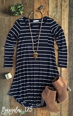Great little basic Navy & White striped long-sleeved flare dress. Front pocket. Shown with the Arrowhead Tusk Shanlou Necklace and the Commerce Booties. Model is wearing a size small. 95% Rayon 5% Spa