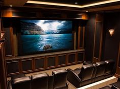 Painted strip of light color between black ceiling and trim to increase rope lighting effect. - .Home Theater Designs From CEDIA 2014 Finalists | Home Remodeling - Ideas for Basements, Home Theaters & More | HGTV