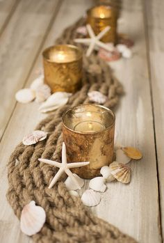 Weave our woven rope table runner between candles in mercury glass candle holders for an enchanting centerpiece fit for any nautical, beach or destination wedding or event!