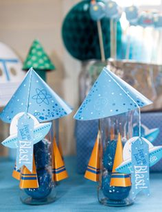 Rockets and Robots party favors. How cute are these?  Homemade play doh in jars decorated like rockets