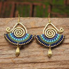 Shaped brass and woven cotton earrings with brass bead