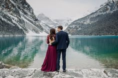 Thinking about visiting Lake Louise in October? See more of this amazing magical snowy Lake Louise engagement session to convince yourself that late fall is the best time to visit the Canadian Rockies! Mountain  engagement photo inspiration. Lake Louise engagement photographer. Best places for mountain engagement photos. Where to do engagement photos in Banff National Park. Rocky Mountain elopement photographer. Lake Louise wedding photographer. Mountain Engagement Photos, Fall Engagement, Engagement Session, Engagements, Mountain Elopement, Local Photographers, Portrait Photographers, Banff National Park, National Parks