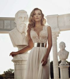"""I'm giving you a reason to break out in your happiest of happy dances on this Tuesday. Because today, dear readers, I've got the most amazing lineup of stop you in your tracks bridal gowns by one truly talented Israeli designer, Julie Vino. Her Fall 2014 collection is """"Everything""""… I'm kind of obsessed and that's read more..."""