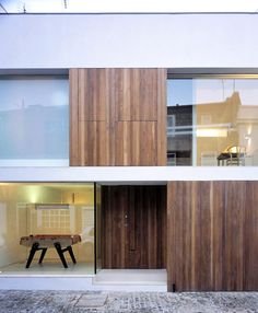 Wood, plaster and glass make for a beautiful facade. The New Mews House by Jonathan Tuckey Design.