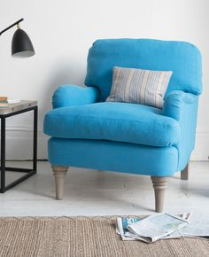 Loaf's comfy blue Jonesy armchair upholstered in a relaxed linen with tall oak legs in this coastal living room