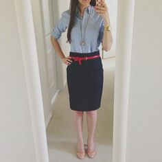 blue oxford button up blouse with denim pencil skirt and red belt
