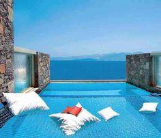 On a poolside hammock overlooking the ocean.