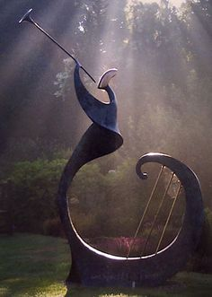 'Geronitius' - by Sandra Bell;  Bronze sculpture of a  figure with a trumpet, with bars at the base to denote bars of music and strings of a harp.