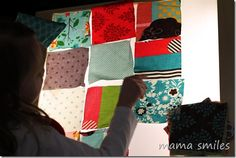 Arranging fabric squares on the light table