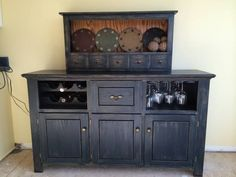 Midnight blue distressed oak buffet and hanging shelf. Buffet measures 62.5 wide x 17 deep x 36 tall. It has 1 large drawer and three door storage spaces. Also a wine rack which can hold six bottles...