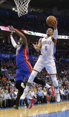 Oklahoma City's Russell Westbrook (0) drives past Detroit's Greg Monroe (10) for a shot during the NBA basketball game between the Oklahoma City Thuder and the Detroit Pistons at Chesapeake Energy Arena in Oklahoma City, Okla. on Wednesday, April 16, 2014.  Photo by Chris Landsberger, The Oklahoman