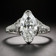 Tiffany & Co. 3.14 Carat 'Moval' Diamond Edwardian Ring - GIA F-VVS2 - From the first or second decade of the last century, a remarkable and resplendent gem by America's premier jeweler - Tiffany & Company. An icy-white, full-figured, old European-cut marquise diamond, with softly rounded tips (sometimes referred to in the trade as a 'Moval' - 1/2 marquise 1/2 Oval), weighing 3.14 carats, is presented with timeless Edwardian elegance and romantic splendor in this platinum and diamond…