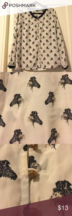 Nwot Unique Zebra pattern blouse, silky material Unique Zebra pattern blouse, silky material, brass buttons Tops Blouses