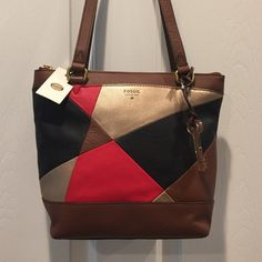 """FOSSIL DAWSON PATCHWORK LEATHER SHOPPER NWT Fossil Dawson small brown 100% leather patchwork shopper. Double handles with a 91/2"""" drop, zipper closure to keep all you belonging safe. Brass-tone hardware, 1 front slip pocket and 1 back slip pocket. Inside 1 zipper pocket, key fob and 2 media pockets. Also comes with Fossil detachable logo key. Never been used FOSSIL Bags Satchels"""