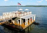 Antiques, travel treasures and rich colors warm up an interior designer's summer home on Alabama's Lake Guntersville