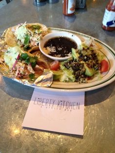Trendy, small & busy - Liberty Kitchen. Fish tacos here with seafood, southern, burger, brisket favorites. 4 out of 5!