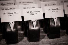 tuxedo favor boxes serving double duty as escort card holders  #weddingfavorideas
