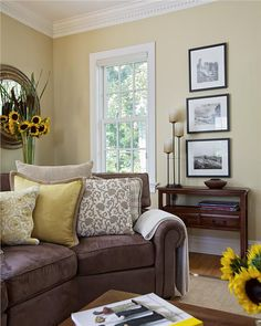 Framed Pictures Stacked Beside Window Above Small Accent Table Eclectic Family Room Design Remodel Decor And Ideas