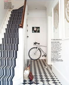 Image from http://www.interiorsbycolor.com/wp-content/uploads/2014/10/blacka-dn-white-hall-and-stairs.jpg.