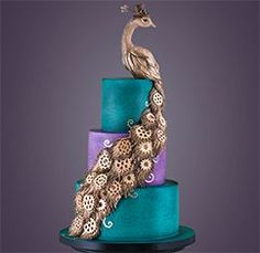 Learn how to make this beautiful Steampunk Peacock Cake for FREE