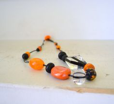 on fire - assymetric beaded necklace - black and orange tones - cotton cord - artisan necklace - free shipping - gift for her