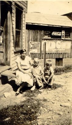 The postmistress at Comfort, WV with her two boys during the depression.