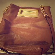 Michael Kors bag Very trendy brown Michael Kors purse with gold handles.  Handles have some scratches. Interior is tan.  Super cute purse!! Michael Kors Bags Crossbody Bags