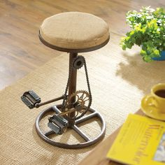 Bicycle stool $149 - Bringing bicycle culture indoors, iron stool is fitted with a nonfunctioning bicycle chain and pedals. (You can't move the pedals, but you can rest your feet on them.)