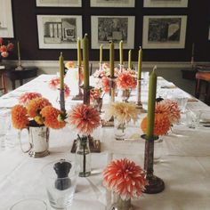Charlie McCormick shows how to decorate a dining table with fresh dahlias at special dinner for Marianna Kennedy Bloomsbury, London September 2015