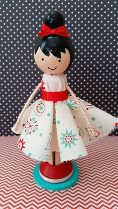 Anna Miniature Wooden Clothespin Doll... Anna, a super cute wooden clothespin doll stands just over four inches tall, and is uniquely hand painted in vibrant colors and wears a real cotton fabric dress....