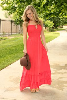Get swept up in the island vibe of steel drums, banana palms, and fruity mixed drinks with this all-coral halter maxi dress. Super cute ruffled skirt with a stretch fit bust and keyhole cut out. Open