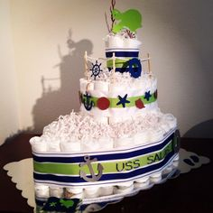 Nautical and turtle theme diaper cake. #anchor #helm #seashell #sanddollar #islandtheme #babyshower #blue and #green #starfish #ship #boat