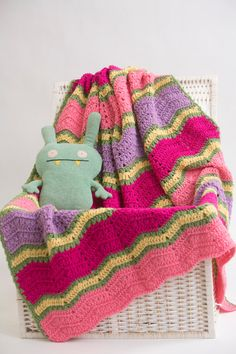 Springtime Ripple Afghan - This bright, imaginative afghan is a must-make blanket for any child's room. You could even drape it over a solid-colored couch for an extra dose of color. From I Like Crochet's April 2014 issue