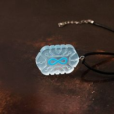 The Lexas Chip or The Flame necklace is an handmade jewel made of transparent acrylic to give a 3D looks with laser engraved the symbol of Infinity. The matt surface is made with fine sandpaper and then painted with enamels. You can choose between two different designs: the